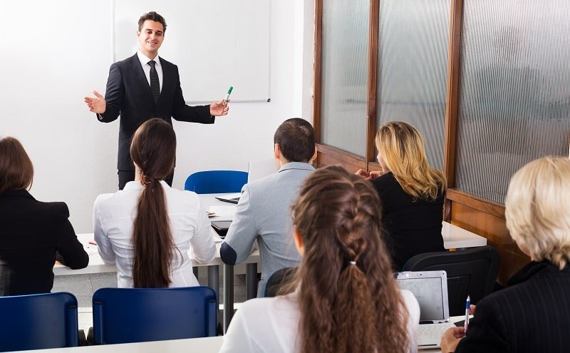 pros and cons of being a Postsecondary Business Teacher